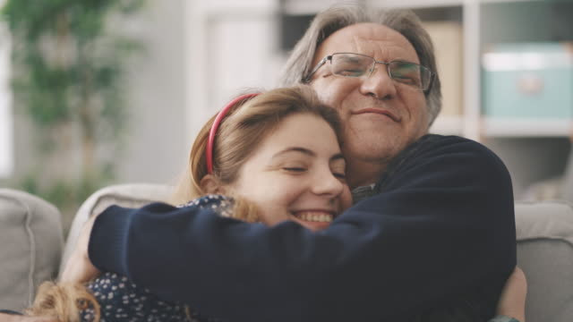 Young daughter hugs her father Young daughter hugs her father hug stock videos & royalty-free footage