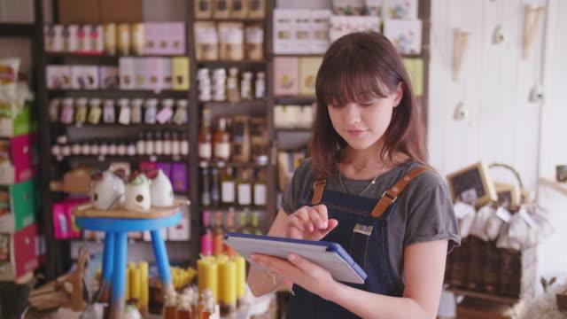 Young Deli Owner Using Digital Tablet In Delicatessen video
