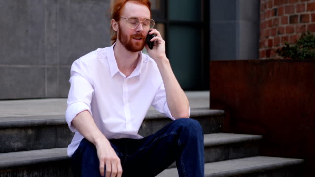 Young Designer Talking on Phone, Negotiating in Good Mood video