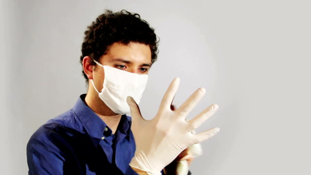 young doctor wearing medical gloves video