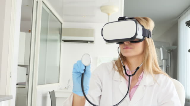 Young doctor with Vr simulator & stethoscope video