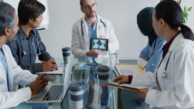 Young doctors consulting together 4k