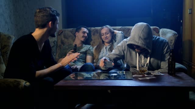 Young drug addicts sitting on the couch indoors video
