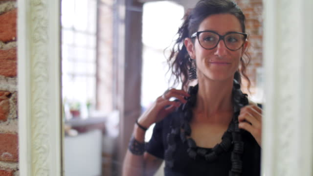 Young eco jewelry maker creating artwork in her atelier video