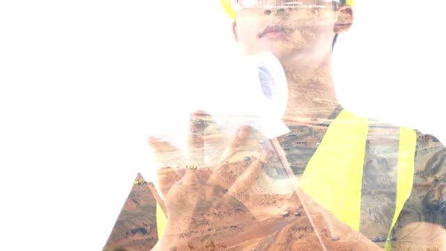 vidéos et rushes de jeune ingénieur au fond de mine de minerai. - image composite numérique