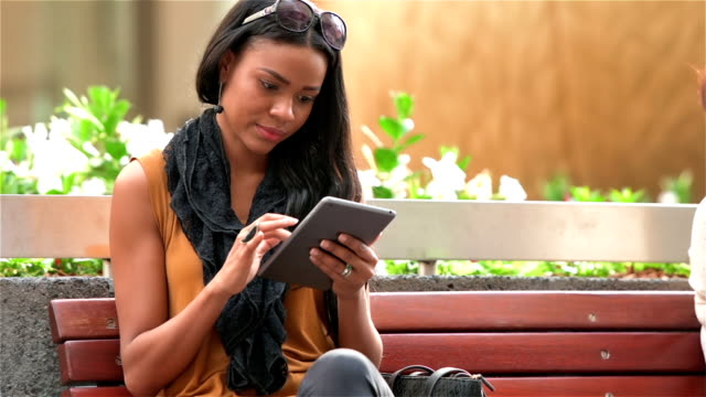 Young entrepreneur woman using tablet video