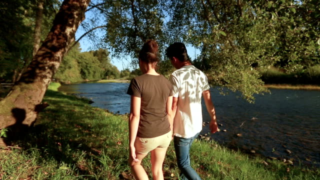 Young ethnic couple spending time together in the great outdoors video