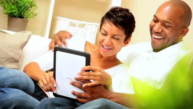 Young Ethnic Couple Using Wireless Tablet for Webchat video