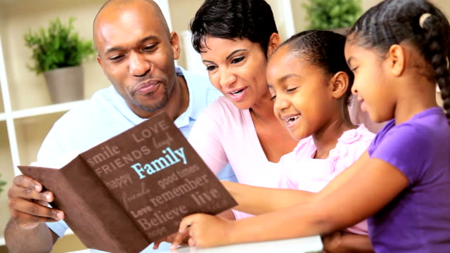 Young Ethnic Family with Photograph Album video