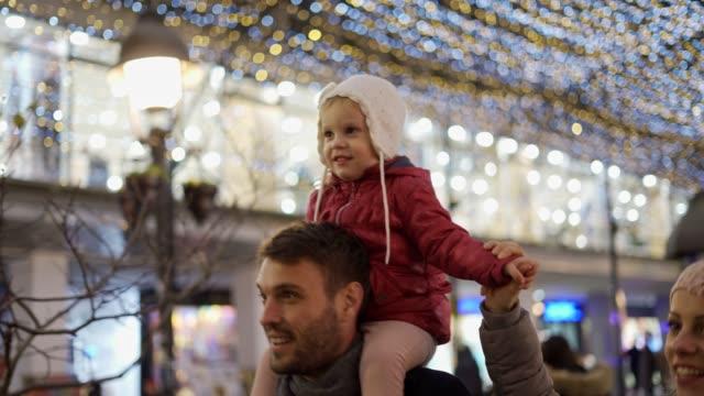 young family enjoying christmas spirit - happy holidays filmów i materiałów b-roll
