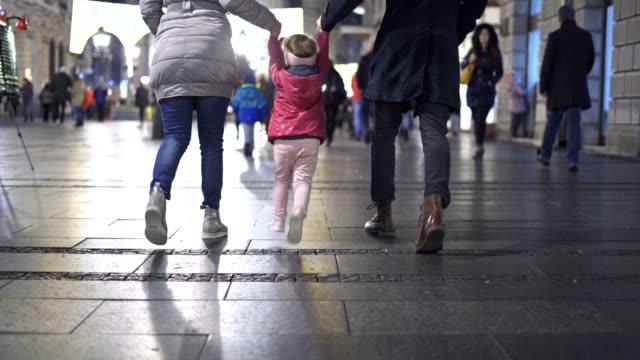 young family enjoying night walk - happy holidays filmów i materiałów b-roll
