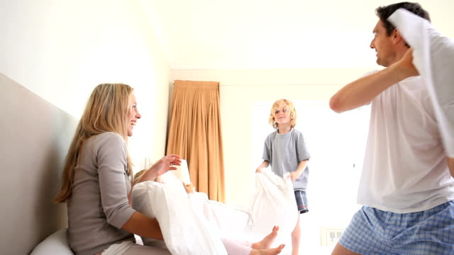 young family having a pillow fight - wrestling stock videos and b-roll footage
