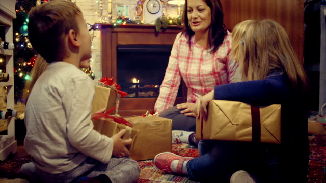 Young Family Opening Christmas Presents video