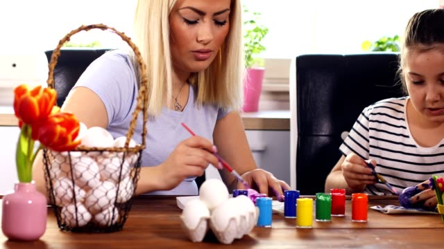 Young Family Painting Easter Eggs video