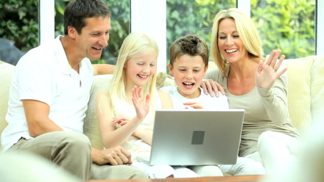 Young Family Using Laptop for Webchat video