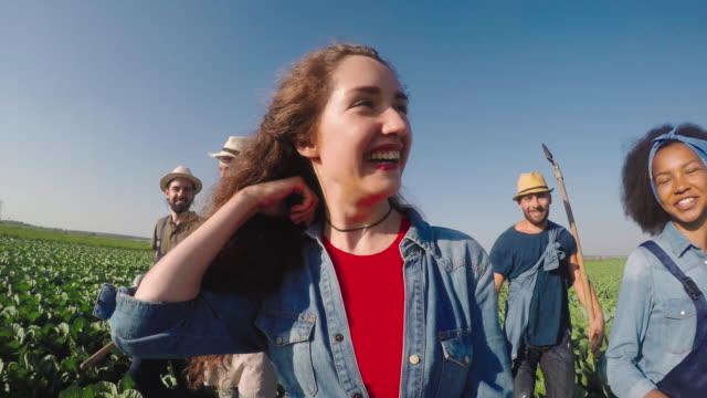 Young Farmers Walking through Field video
