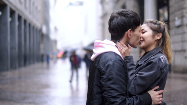 Young fashion lovers at beginning of love story Young Asian couple in the city falling in love stock videos & royalty-free footage