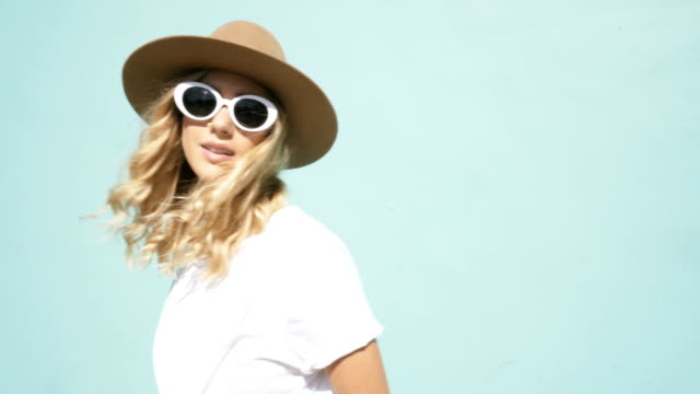 young fashionista girl with sunglasses. california lifestyle video