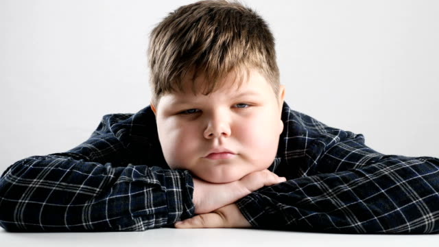 Young fat boy tired and bored 50 fps Young fat boy tired and bored 50 fps 4k fat nutrient stock videos & royalty-free footage