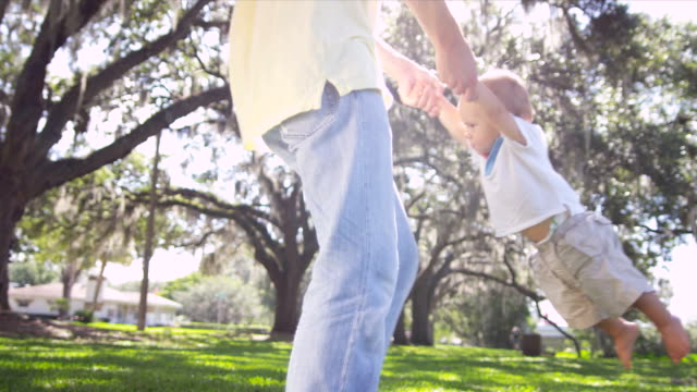 Young Father Swinging Cute Little Caucasian Boy Air video