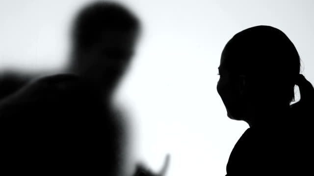 Young female arguing husband shadow, relations difficulties, couple conflict