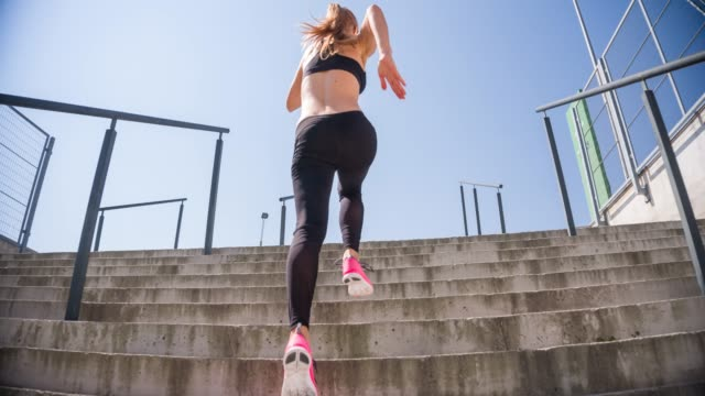 young female athlete running up the stairs - staircases stock videos & royalty-free footage