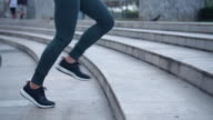 istock Young female athlete running up the stairs,Slow motion 1085977402