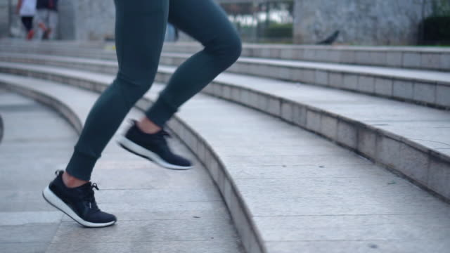 Young female athlete running up the stairs,Slow motion Young female athlete running up the stairs,Slow motion staircases stock videos & royalty-free footage