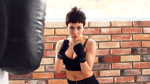 young female boxer training fitness boxing at gym - kick boxing video stock e b–roll