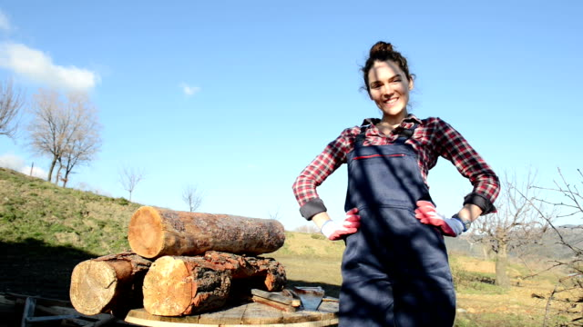 Young female carpenter posing outdoors video
