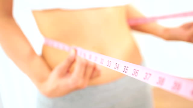 Young Female Checking Body Size Loss video