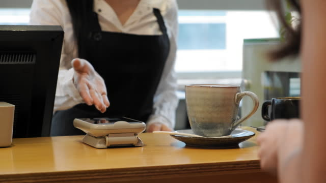 Young Female Customer Making Mobile Payment for Coffee Drink video