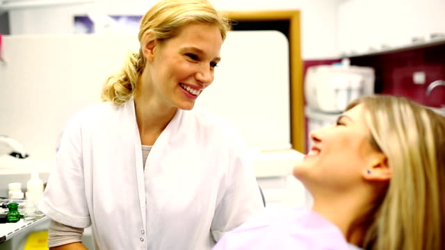 young female dentist examining patient - dentist stock videos & royalty-free footage