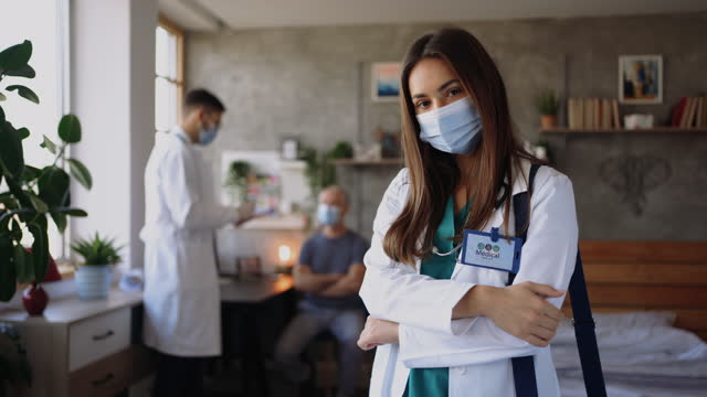 Young female doctor posing for a photo with a facemask video