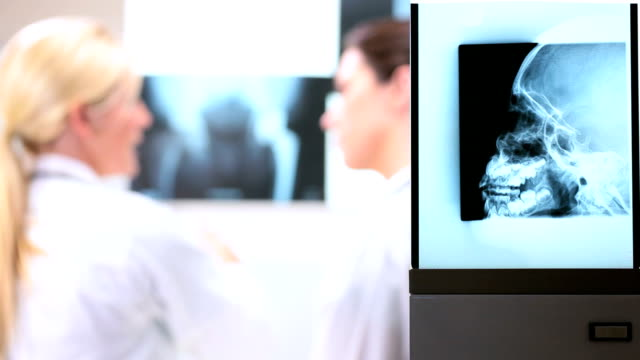 Young Female Doctors Looking at X-Rays video