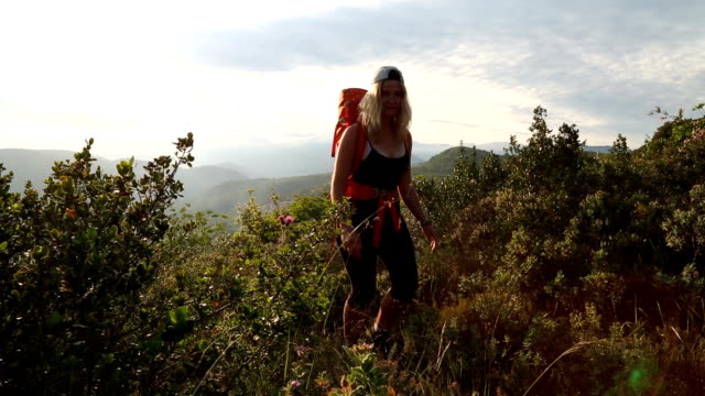 Young female hiker explores Mediterranean hilltop First person perspective pedal pushers stock videos & royalty-free footage