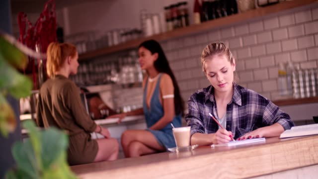 young female hipster artist drawing sitting alone in urban cafe - banchi scuola video stock e b–roll