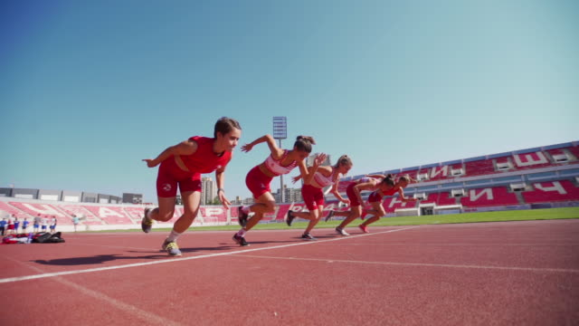 Young female runners in starting blocks Group of teenage girl on a athletic training athleticism stock videos & royalty-free footage