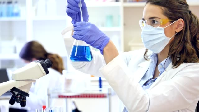 Young female scientist conducts research in laboratory