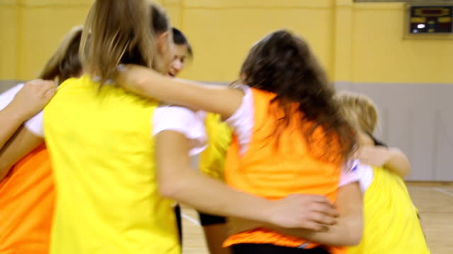 Young female team celebrating success Group of young women celebrating successful game,laughing and holding each other,stacking with hands volleyball sport stock videos & royalty-free footage