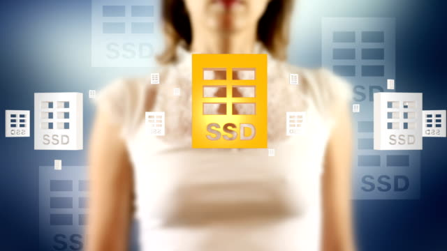 Young Female Touching On Screen SSD Disk Symbols Appears video