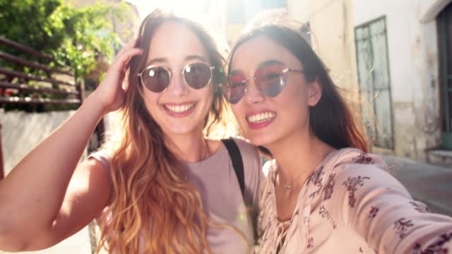 Young female tourists taking a selfie in old Italian town