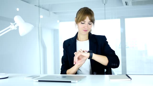 Young Female Using Smartwatch at Work in Office video