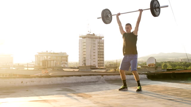 Young fit athlete man doing Clean and Jerk video