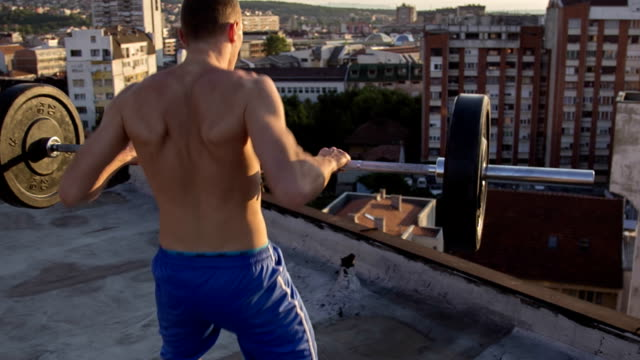 Young fit athlete man doing Strict Press video