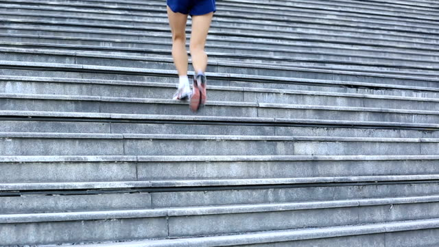 young fitness woman runner running on stairs video