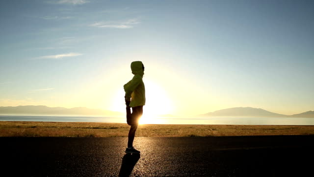young fitness woman runner running on sunrise seaside trail video