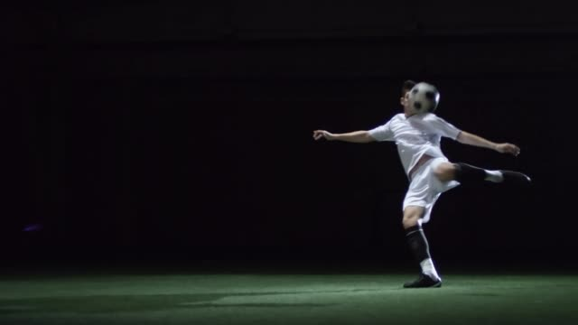Young Footballer Shooting a Ball video