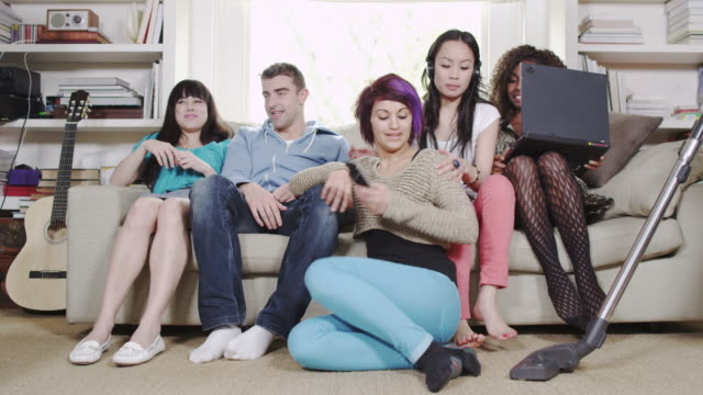Young friends and a vacuum cleaner  medium group of people stock videos & royalty-free footage