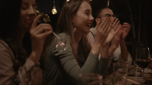 Young friends celebrating, eating and drinking at rustic dinner party video